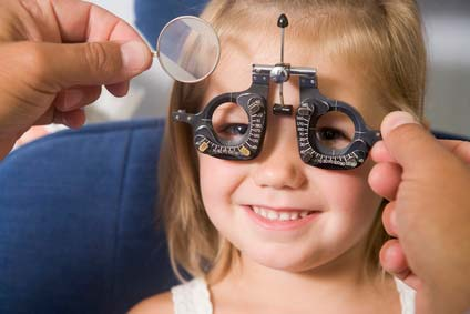 Optician eye test of girl